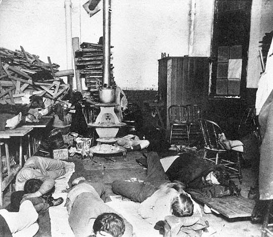 Institutional Flophouse. To Both Sides, Note The Feet Of Men Sleeping On  Platforms And Chairs.